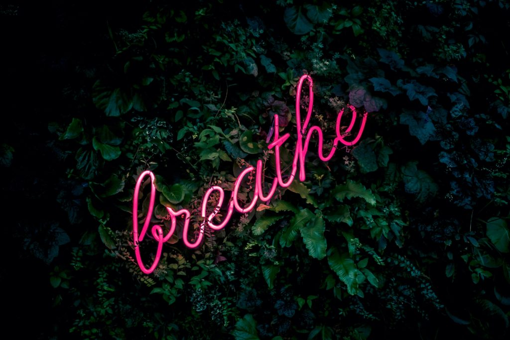"""An image of a light spelling the word """"Breath"""" in pink neon: through the dramas of the gluten-free diet"""