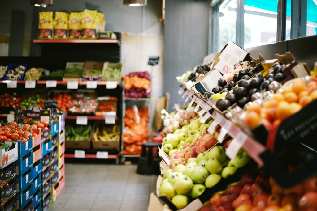 Photo of the fruits and vegetables section of a grocery store